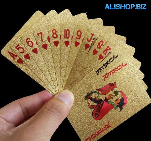 A set of playing cards in a gold design